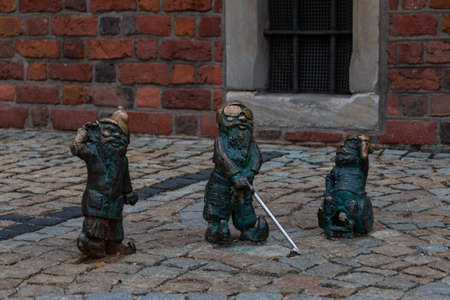 A picture of three disabled gnomes as seen in Wroclaw.