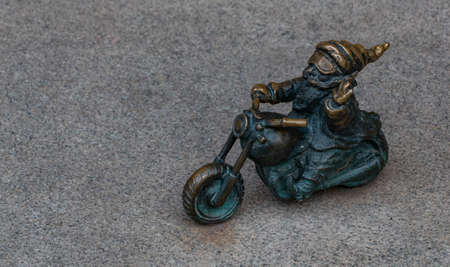 A picture of a biker gnome as seen in Wroclaw.