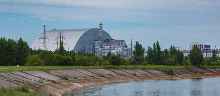 A picture of the third and fourth reactors of the Chernobyl nuclear power plant, with the recent giant dome covering the fourth one.