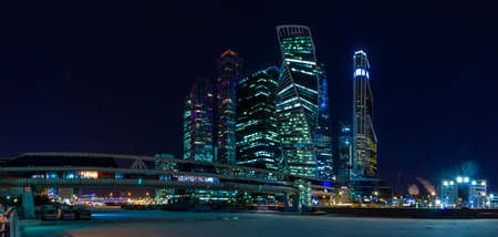 A night panorama of the Moscow City buildings.