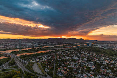 A picture of the north side of Vienna during a dramatic sunset.