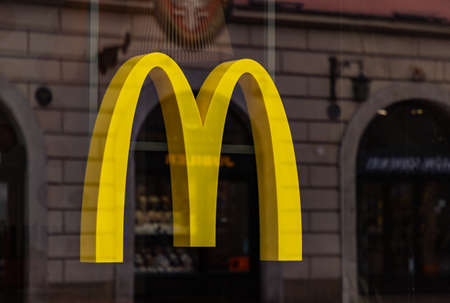 A picture of the McDonald's logo on display in front of one of the establishments.