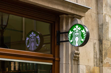 A picture of the Starbucks logo on display in front of one of the establishments.