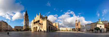 A panorama picture of Kraków's Main Square (Rynek Główny), which includes the Town Hall Tower, The Cloth Hall and St. Mary's Basilica.