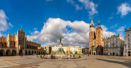 A panorama picture of Kraków's Main Square (Rynek Główny), which includes the Adam Mickiewicz Monument, The Cloth Hall and St. Mary's Basilica.