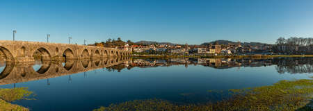 A panorama picture of the town of Ponte de Lima and the iconic Lima Bridge (or Ponte de Lima, as the bridge gave name to the town as well). Stock Photo