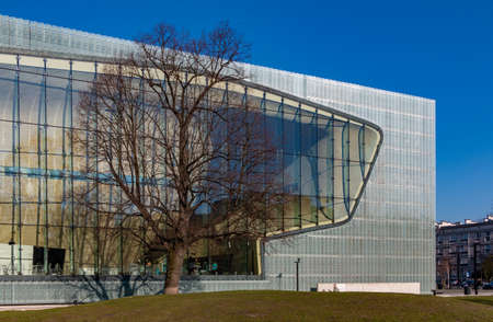 A picture of the POLIN Museum of the History of Polish Jews building as seen from the outside.