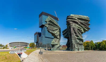 A picture of the Silesian Insurgents' Monument, the Spodek and the .KTW building complex.