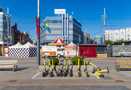 A picture of Katowice's yellow electric scooters from Zipp on the main square.