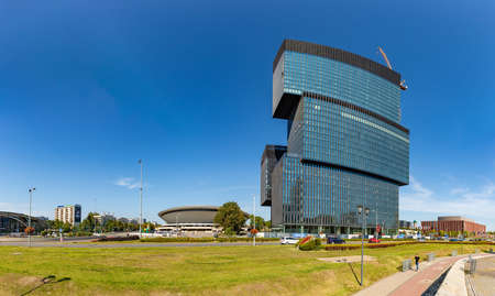 A picture of the Spodek and the .KTW building complex taken from the Katowice roundabout.