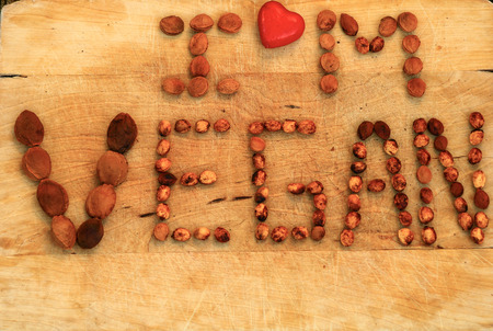 i am vegan with red heart on yellow wooden board 写真素材