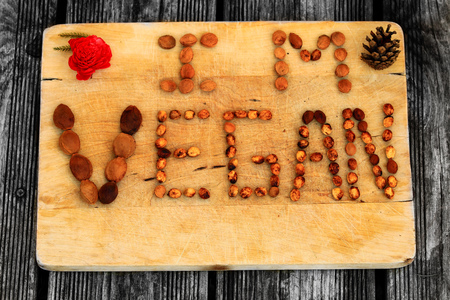 i am vegan with dried fruit and flower on wooden background