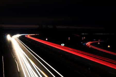 Lightpainting of a highway at night with road traffic. Spun from car headlights in long exposure mode. 版權商用圖片 - 159633268