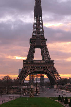 Paris, France. December 30. 2020. View on the Eiffel tower at sunrise or sunset. Dramatic sky with sunlight and cumulonimbus. Historic monument.