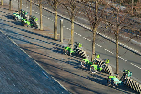 Paris, France. February 14. 2021. Row Electric-assisted bicycle, ecological alternative against pollution. Ecological urban transport. Velib rental station.