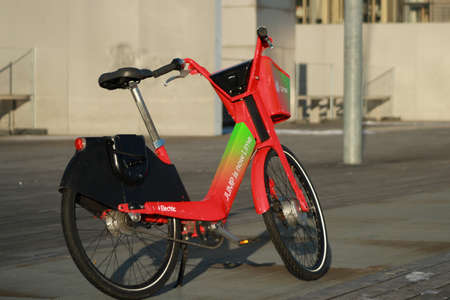 Paris, France. February 14. 2021. Lime rental station of transportation. Row Electric-assisted bicycle, ecological alternative against pollution. Ecological urban transport. 新聞圖片