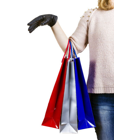 Woman with shopping bags and white background photo