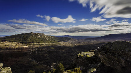 scalar: High mountain landscape in a cloudy day Stock Photo