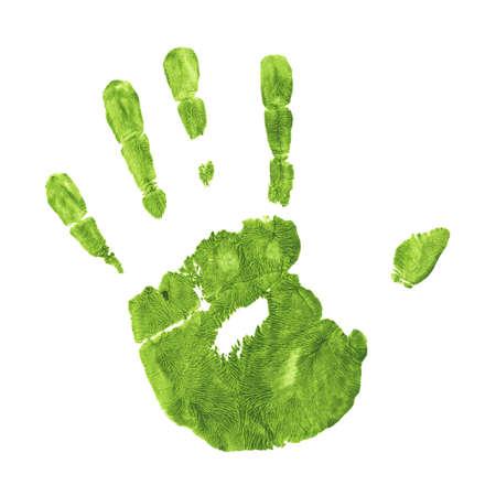 平らな表面に対して手の緑の印象