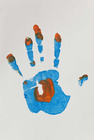 Blue and Orange Left Hand-print on Textured Paper photo