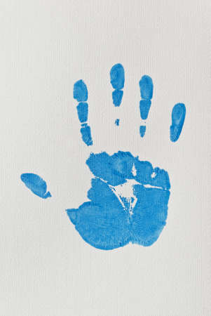 Blue Right Hand-print on Textured Paper Stock Photo - 10629036
