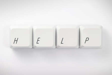 Computer Keys Spelling the Word  Help   keys have clipping path Stock Photo - 20830851