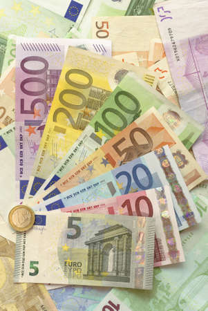 20 euro: Euro Bills With One Euro Coin Vertical Background