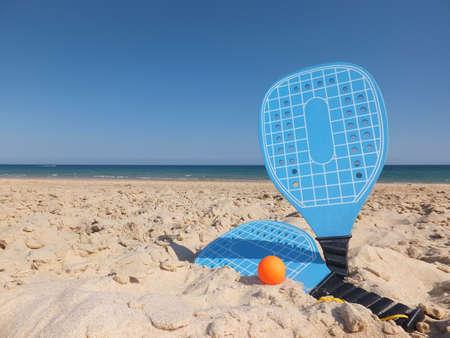 rackets: Blue Beach Rackets on Sand at The Beach