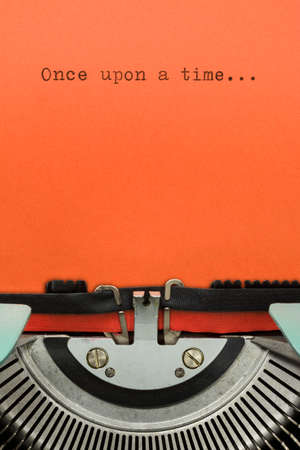 once: Vintage Typewriter With Phrase Once upon a time... Typed in Orange Paper
