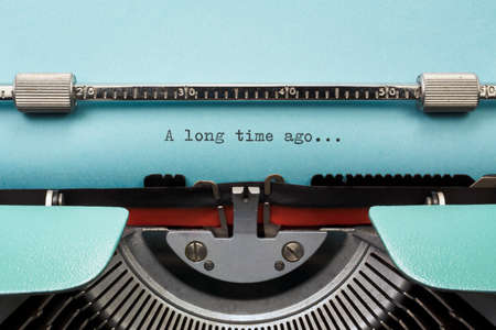 long  ago: Vintage Typewriter With Phrase A long time ago... Typed in Blue Paper