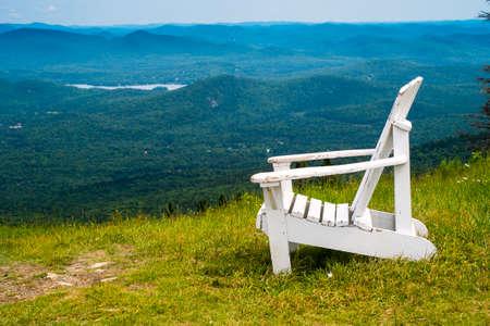 White Adirondack Chair atop a Ski Resort in Summer