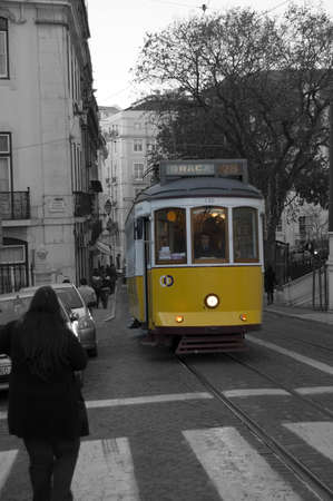 tramcar: Person waiting for the tramcar at the sunset in the Old part of the city Lisbon, Portugal