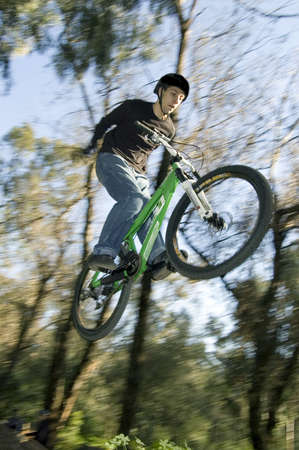 btt: extreme riders flying with they bikes Stock Photo