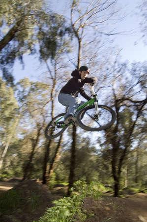 btt: rider flying over a jump x up