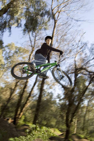 rider jumping over a jump in great style Stock Photo