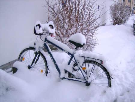 frozen bike, lots of white pure snow photo