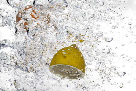 Close-up of fruit floating in bubbly water