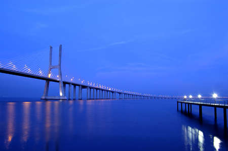 Vasco da Gama Bridge over the tagus river is the largest bridge in all Europe photo