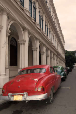 typical havana street, with a vintage car . Cuba