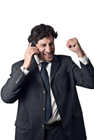 Ausdruck der ein erfolgreicher Geschäftsmann im Gespräch über ein Mobiltelefon Standard-Bild - 3050754