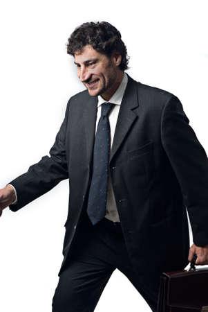 Walking Geschäftsmann mit einem glücklichen Gesicht, weißem Hintergrund  Standard-Bild - 3050751