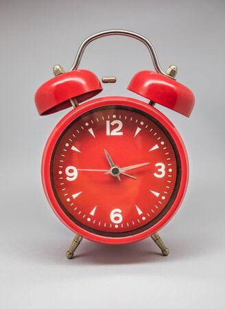 A clock and retro alarm clock, old model known for its sound. Zdjęcie Seryjne