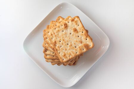 Delicious square cookies, stacked, fresh, crispy, toasted and buttery. Perfect with a breakfast or an afternoon snack.