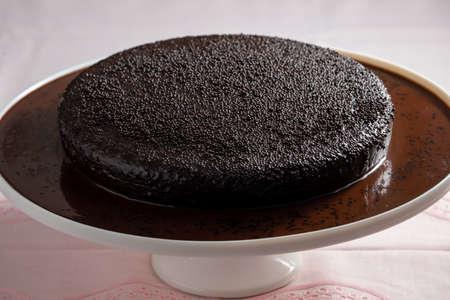 Dark vegan chocolate cake on the table