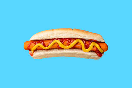 Hot dog with ketchup and mustard on white bread.