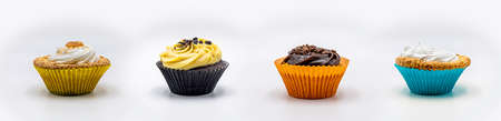 Cupcakes of different flavors on a white background. Stock Photo