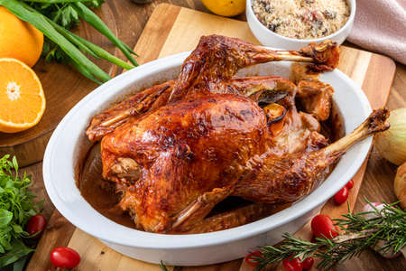 A turkey roasted in a bowl, for Thanksgiving Day and Christmas dinner. Standard-Bild