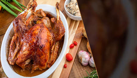 A turkey roasted in a bowl, for Thanksgiving Day and Christmas dinner. Space for text. Top view.
