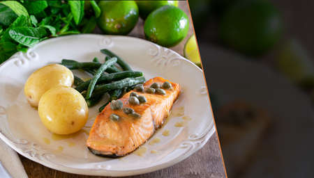 Grilled salmon fillet with caper sauce, potatoes, garlic, parsley and green beans. Selective focus. Space for text. 免版税图像