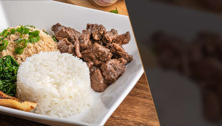 Minced beef tenderloin. Traditional Brazilian food (Picadinho). Selective focus. Space for text.